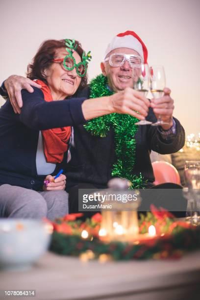 senior couple santa hats