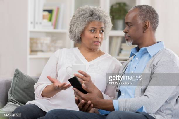 senior couple in serious discussion at home - close to stock pictures, royalty-free photos & images