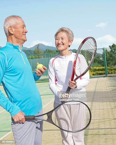 Senior Couple In Tennis Court