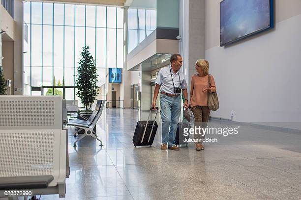 Senior couple in the airport