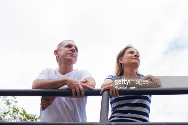 senior couple in the park watching the landscape - beautiful wife pics stock pictures, royalty-free photos & images