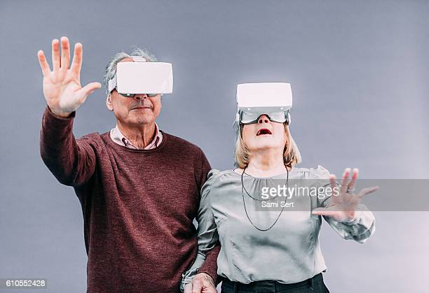 Senior couple in virtual reality experience