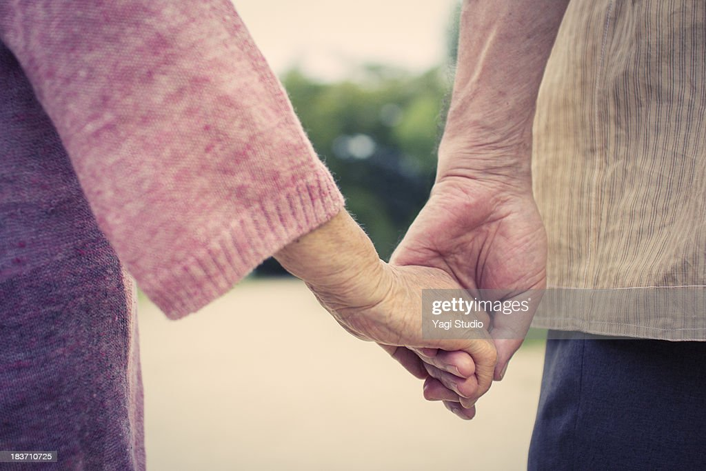 A senior couple is holding hands : Stock Photo