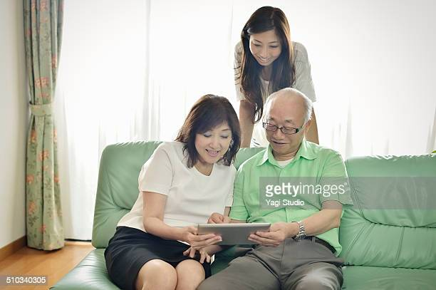 Senior couple is using a digital tablet