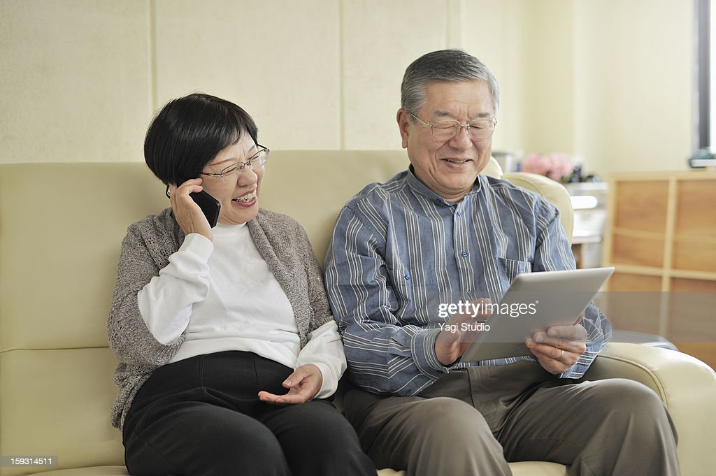 Senior couple is using digital gadgets : Stock Photo