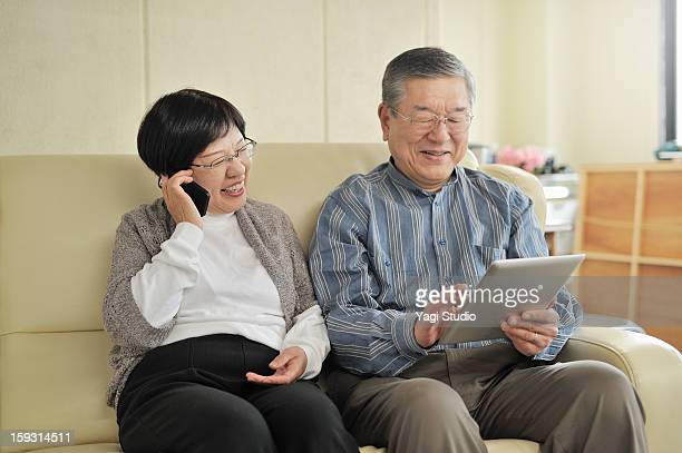 Senior couple is using digital gadgets