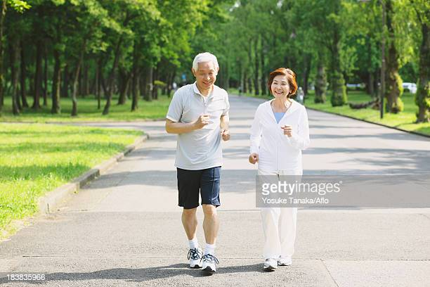 Senior couple jogging in a park