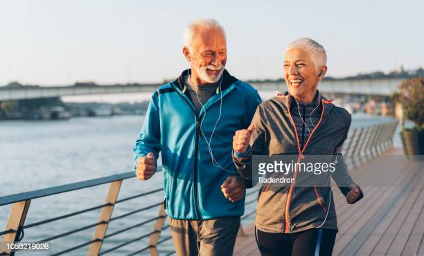 senior couple jogging - jogging stock pictures, royalty-free photos & images