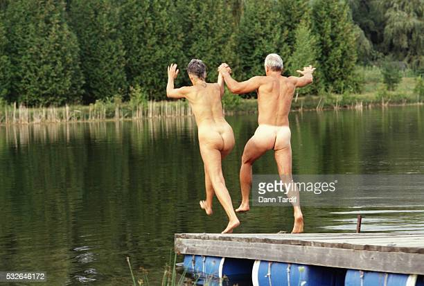 Senior Couple Jumping into Lake