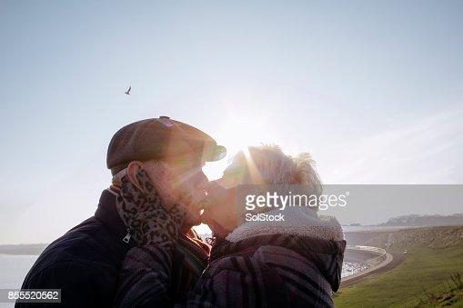 Senior Couple Kiss on the Coast