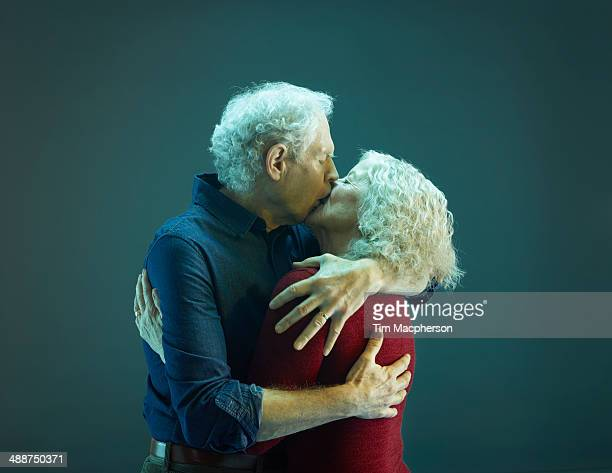 senior couple kissing - kissing stock pictures, royalty-free photos & images