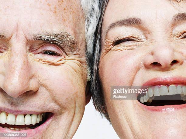 senior couple laughing, close-up - stralende lach stockfoto's en -beelden