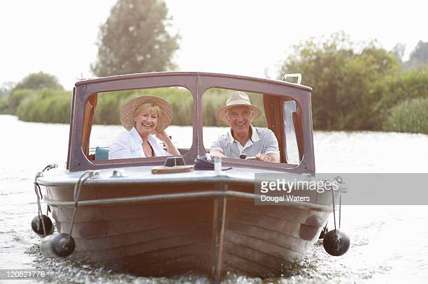 Senior couple laughing on boat.