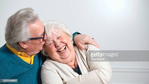 senior couple laughing - wife stock pictures, royalty-free photos & images