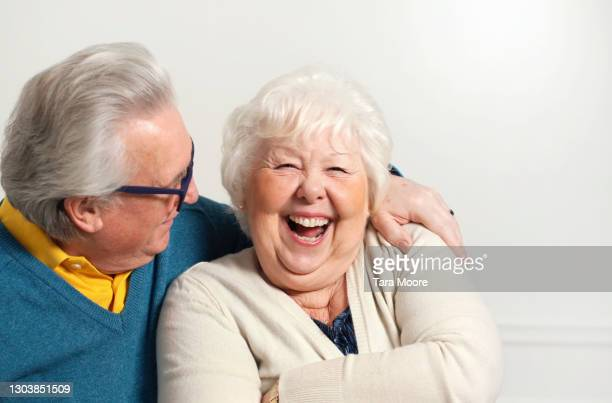 senior couple laughing - men laughing stock pictures, royalty-free photos & images