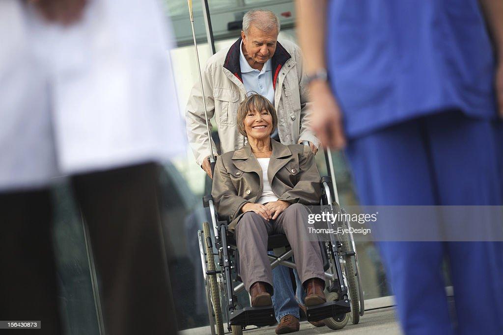 Senior couple leaving the Hospital : Stock Photo