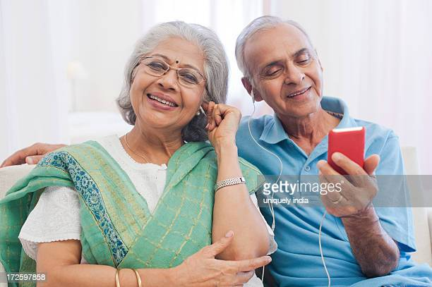 Senior couple listening to music with an MP3 player