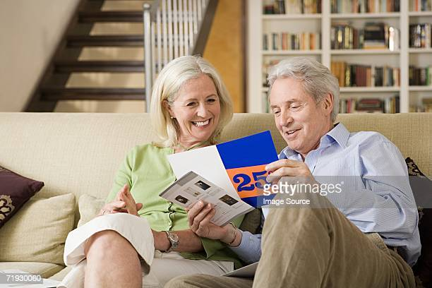 Senior couple looking at a brochure