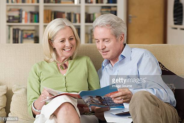 Senior couple looking at a brochure