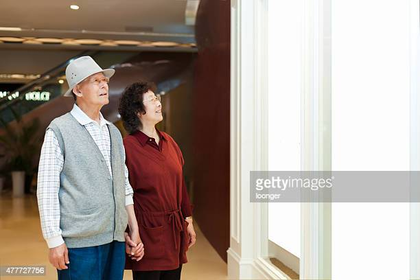 Senior couple looking at blank frame
