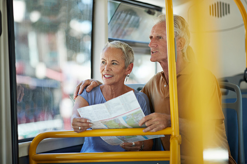 Senior couple looking at map, while riding public bus - gettyimageskorea