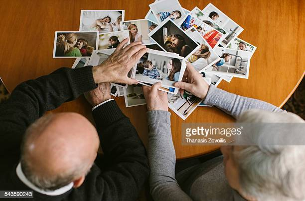 Senior couple looking at photos