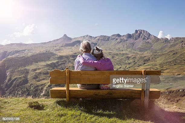 senior couple looking at spitzmeilen, flums, switzerland - sitzbank stock-fotos und bilder