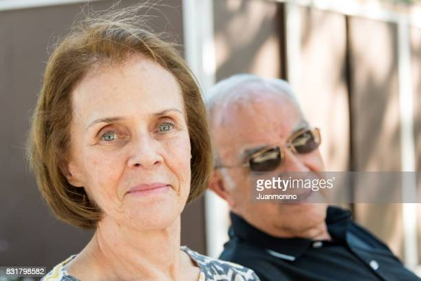 Senior couple looking at the camera