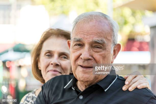 senior couple looking at the camera - southern european descent stock pictures, royalty-free photos & images