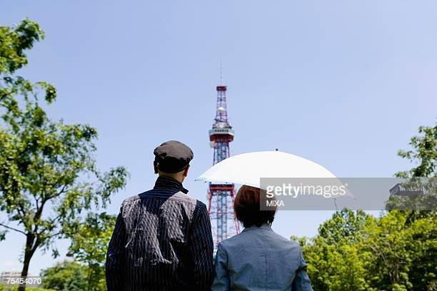 Senior couple looking at tower, rear view