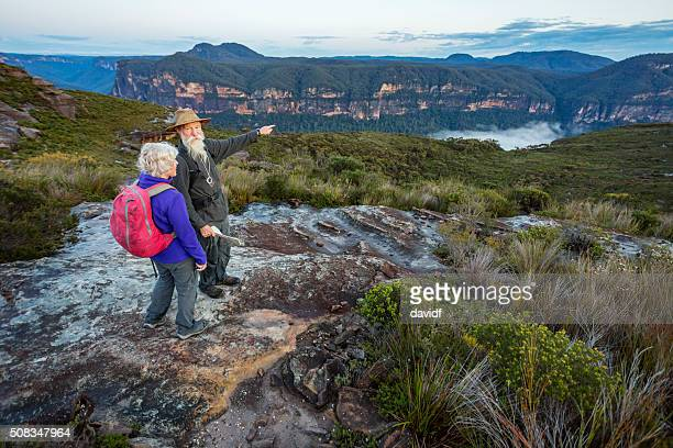senior couple looking at view while bushwalking in australia - blue mountains national park stock pictures, royalty-free photos & images