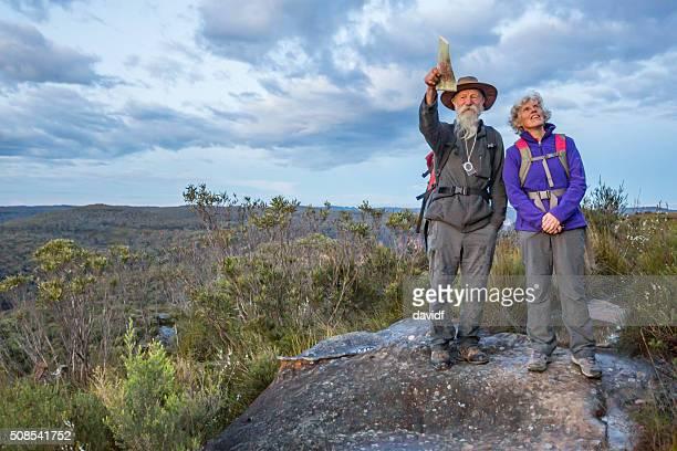 Senior Couple Looking at View While Bushwalking in Australia