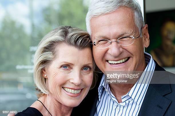 Senior Couple Looking to Camera