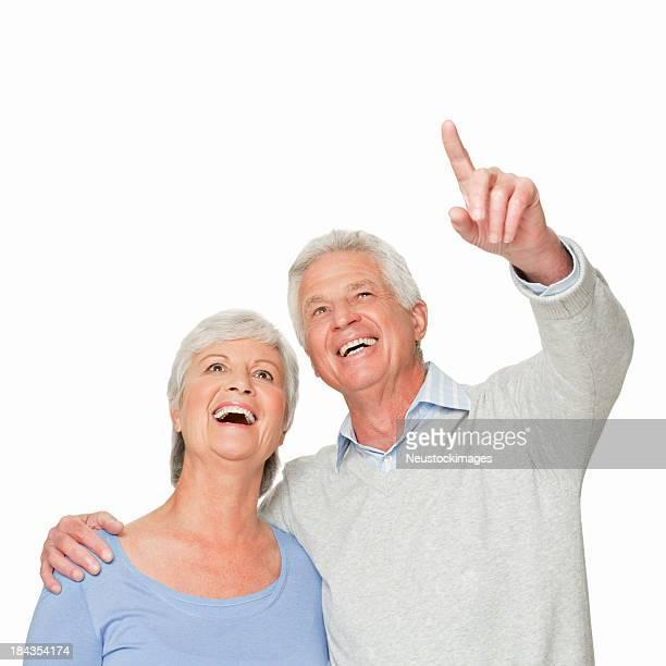 Senior Couple Looking Upwards - Isolated