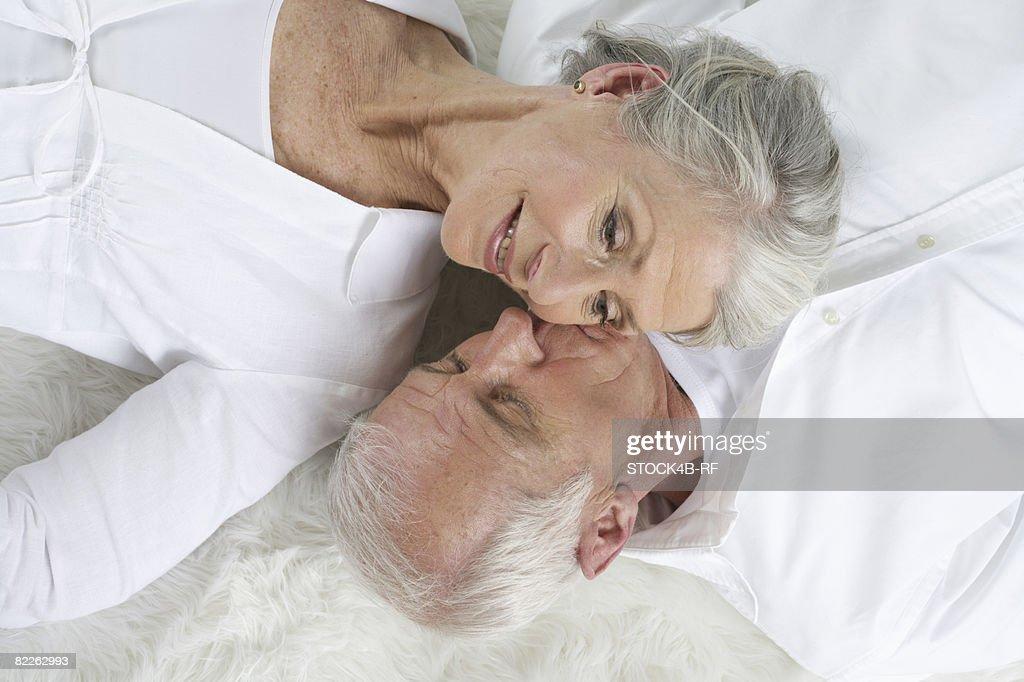 Senior couple lying head to head : Stock Photo
