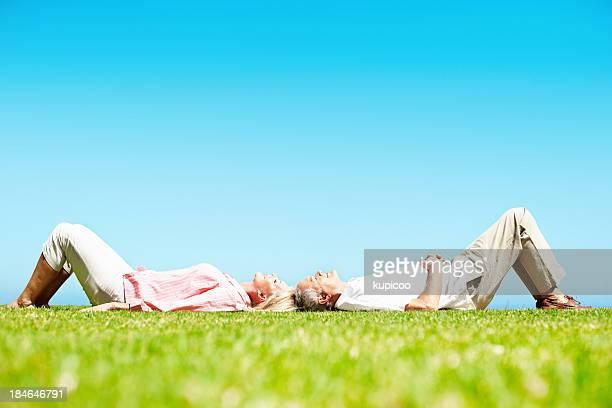 Senior couple lying together