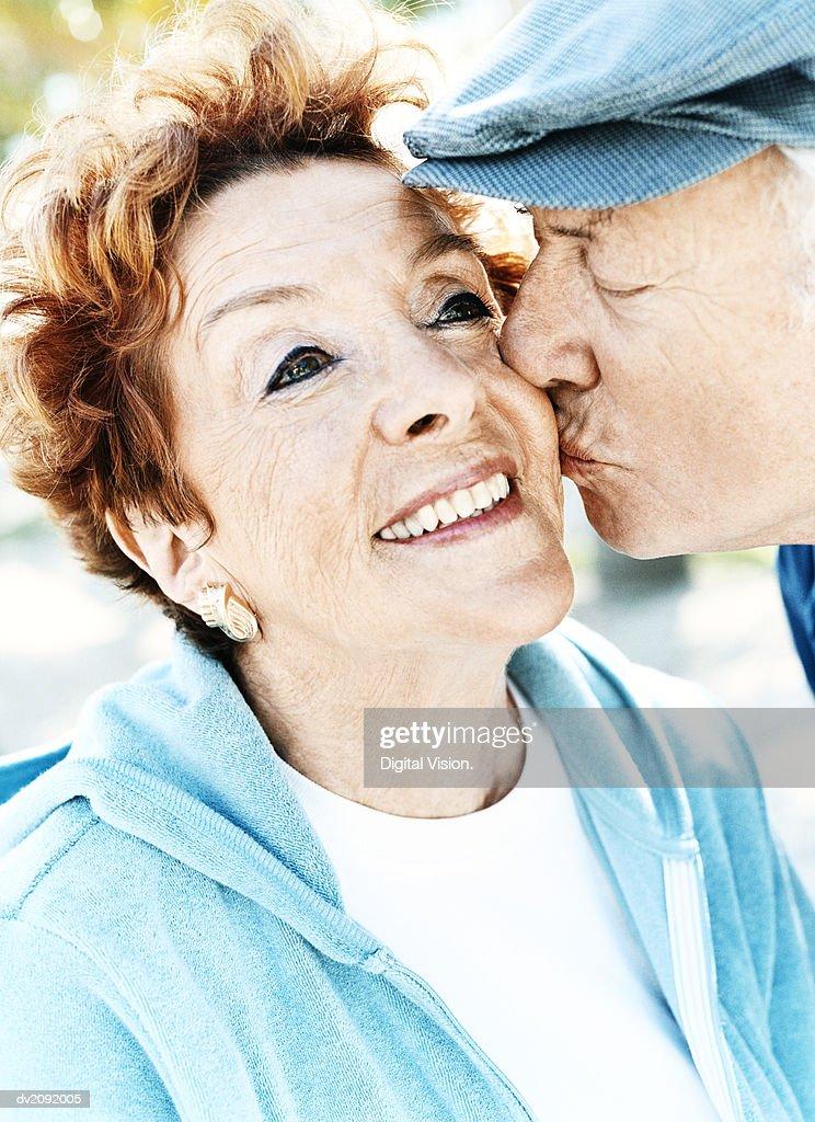 Senior Couple, Man Kissing the Woman's Cheek : Stock Photo