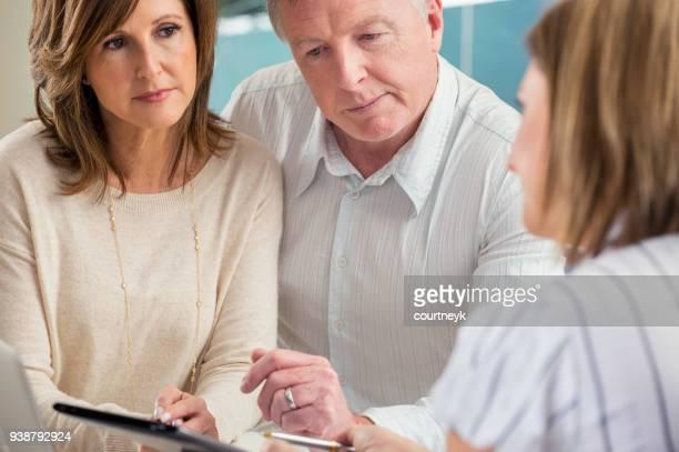 Senior Couple Meeting with Financial Advisor.