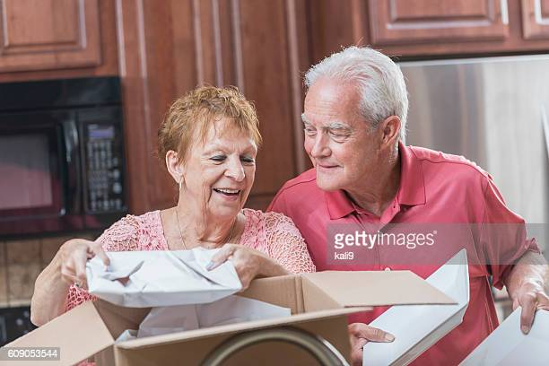Senior couple moving house, in the kitchen
