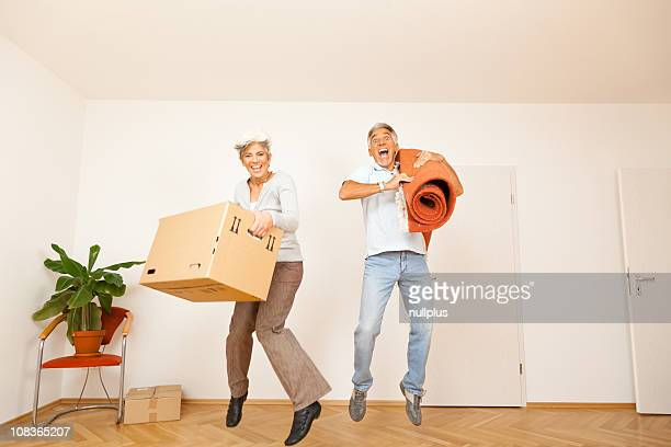 senior couple moving into a new apartment