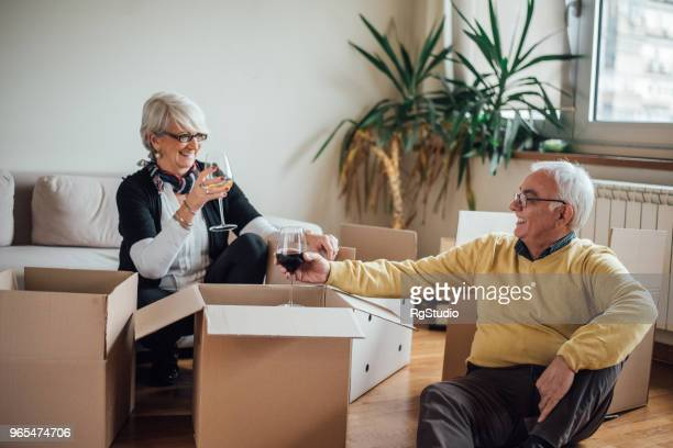 Senior couple moving to new apartment