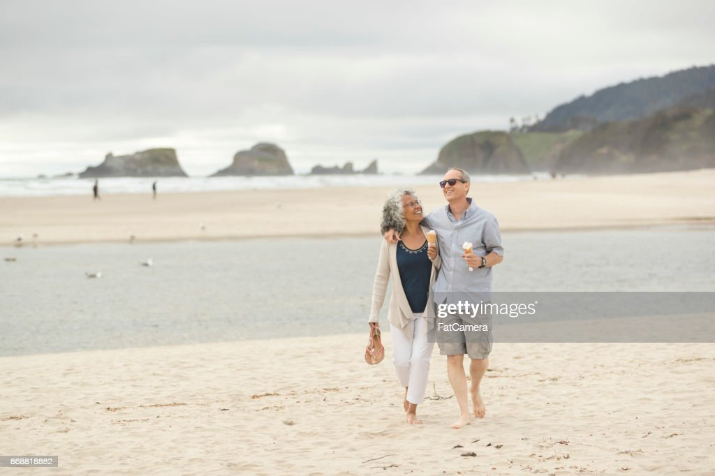 Senior couple on a date at the beach : Stock Photo