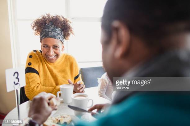 senior couple on a date in a cafe - whitley bay stock pictures, royalty-free photos & images