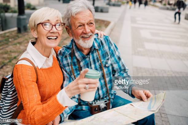 senior couple on a journey exploring the city and enjoying - studio city stock pictures, royalty-free photos & images