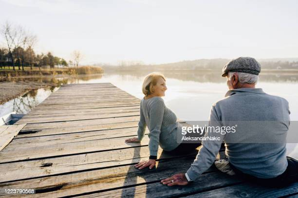 Senior couple on a lake dock