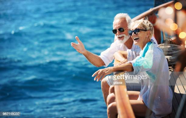 senior couple on a sailing cruise. - ricchezza foto e immagini stock
