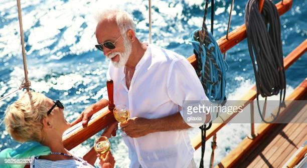 Senior couple on a sailing cruise.