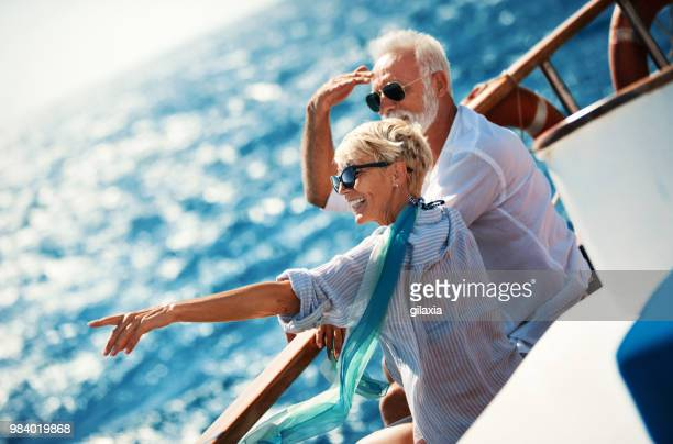 senior couple on a sailing cruise. - boat stock pictures, royalty-free photos & images