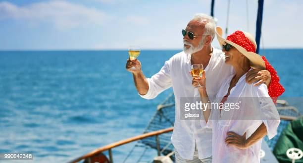 senior couple on a sailing cruise. - yacht foto e immagini stock