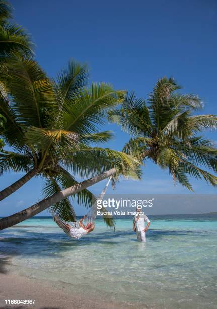senior couple on a tropical beach - vilamendhoo stock photos and pictures